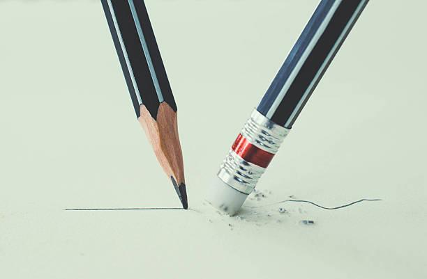close up of a pencil eraser removing a crooked line - schulwechsel stock-fotos und bilder