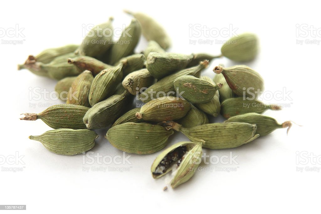 Close up of a pile of cardamom pods stock photo