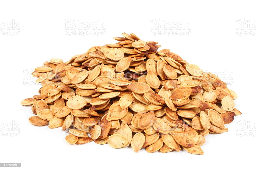 Close up of a pile of dried pumpkin seeds royalty-free stock photo