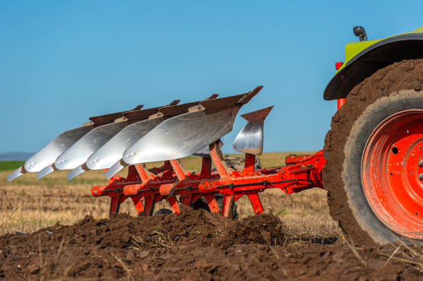 Close up of a plough in action in a field in Dumfries and Galloway south west Scotland A plough being used in late summer to prepare a field and make it ready to sow a new crop to harvest next year johnfscott stock pictures, royalty-free photos & images