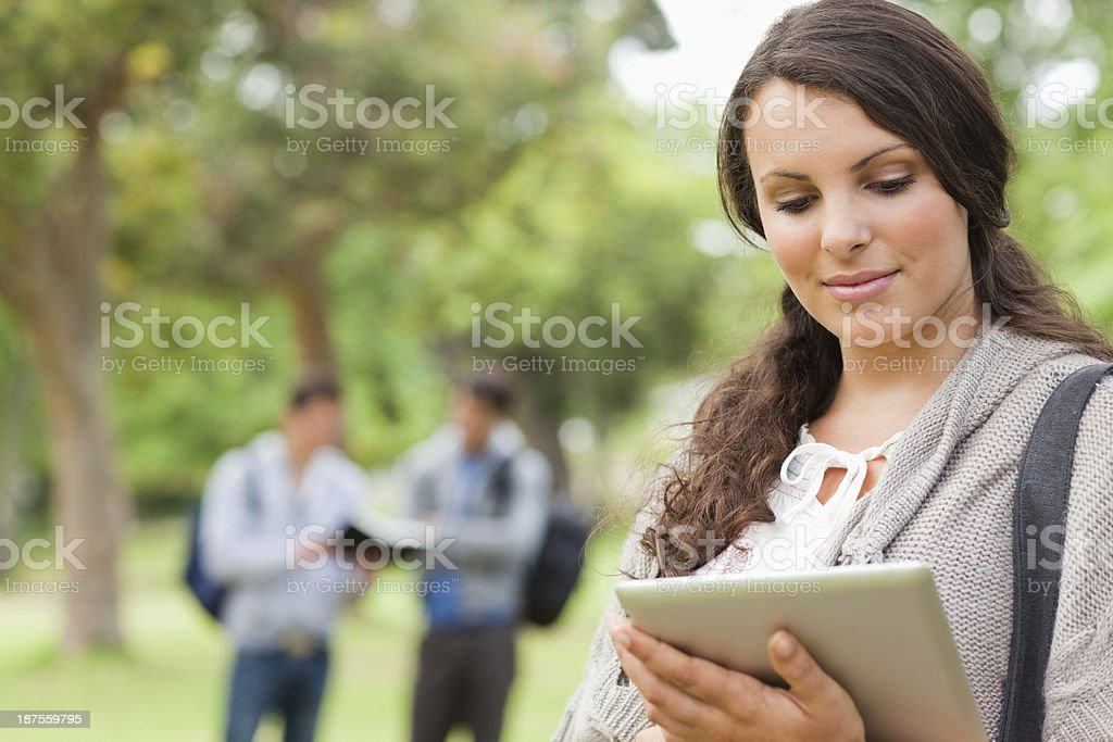 Close up of a pretty brunette using touch pad royalty-free stock photo