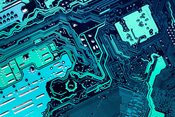 close up of a printed blue computer circuit board - mother board stock pictures, royalty-free photos & images