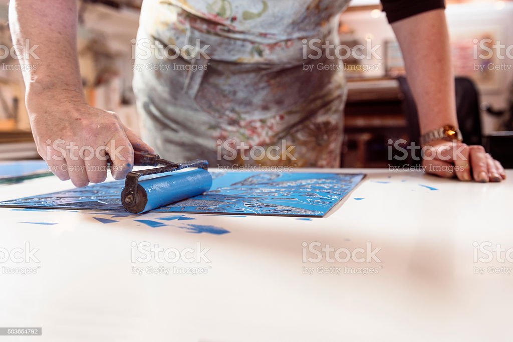 Close Up  of a Printmaker Artist At Work stock photo