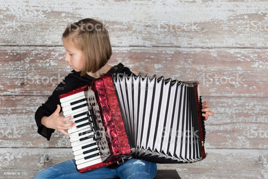 Close up of a professional accordionist focused on playing the accordion stock photo