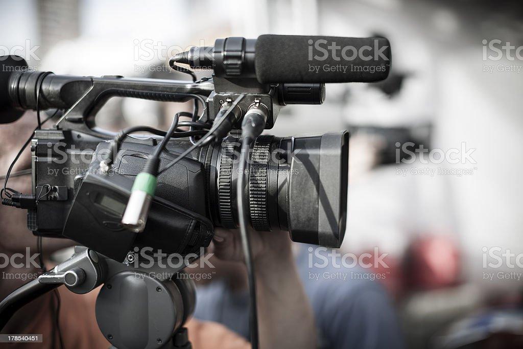 Close up of a professional camera at a news shooting stock photo