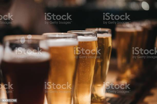 Close up of a rack of different kinds of beers dark to light on a picture id900850266?b=1&k=6&m=900850266&s=612x612&h=mca4zka pgawmr hkc6r1rgib6s8bzsgnqoaczf0ovq=