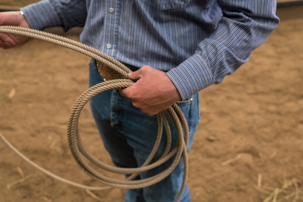 Close up of a rancher holding lasso rope stock photo