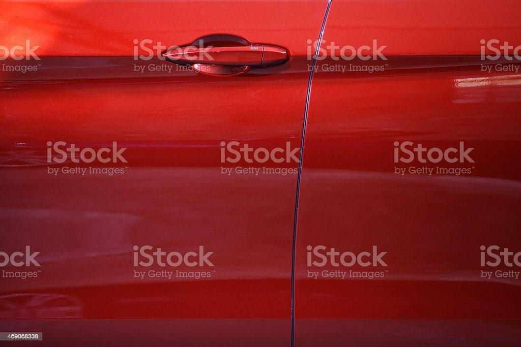 Close up of a red car door handle stock photo