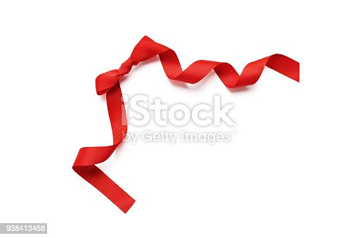 875685464istockphoto close up of a red ribbon bow isolated clipping mask on white background, top view 938413458