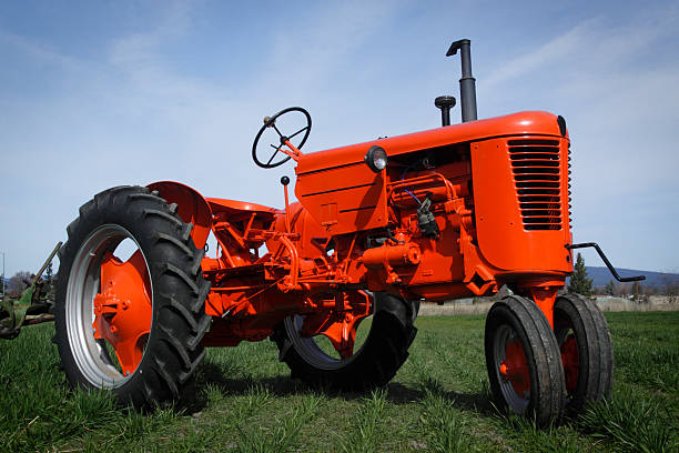 Close up of a red tractor on grass