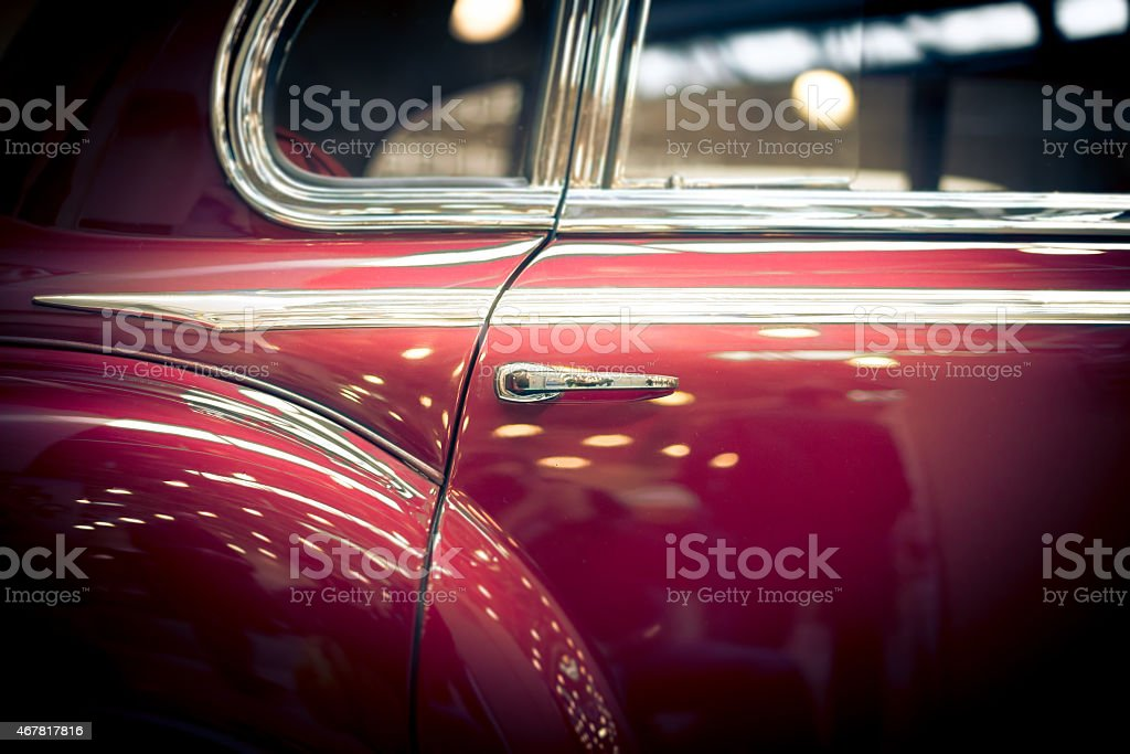 Close up of a red vintage car door stock photo