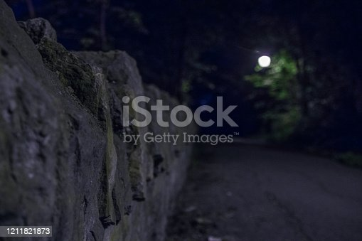 Close up of a Rock Wall at night on a walkway