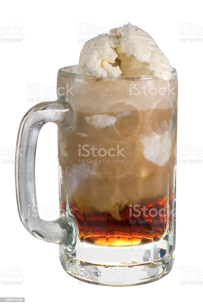A close up of a root beer float in a glass mug stock photo