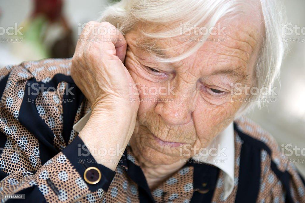 A close up of a sad elderly woman stock photo