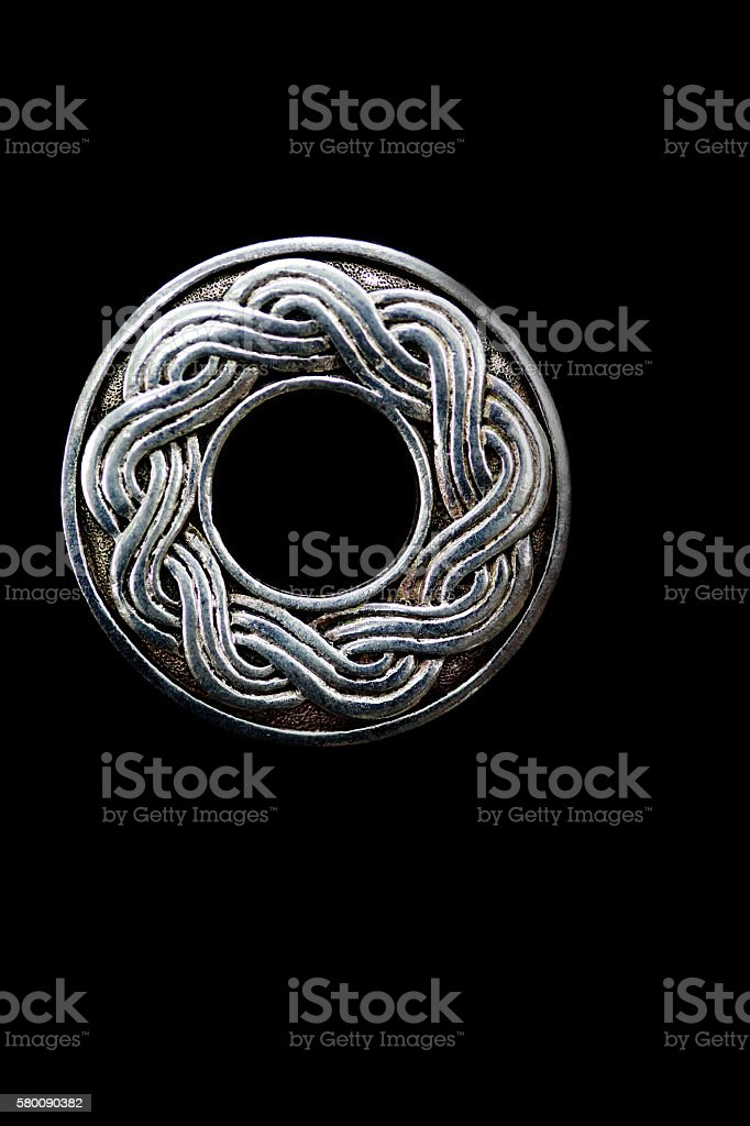 Close up of a silver celtic type symbol stock photo