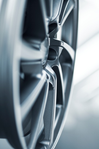 istock close up of a silver wheel rim, background 165782673