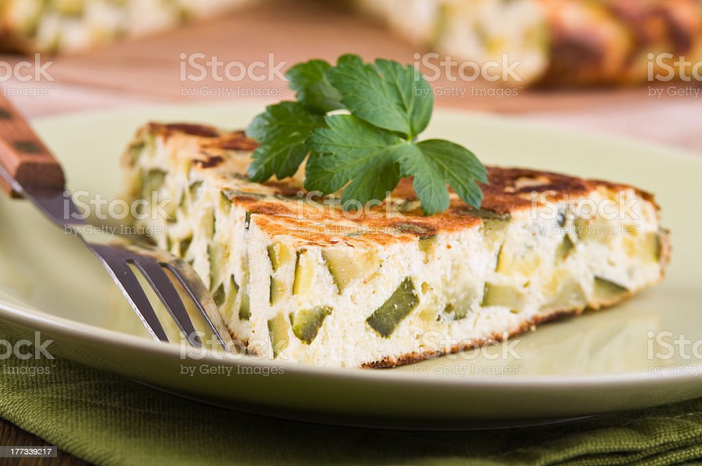 Close up of a slice of Italian omelets with zucchini stock photo