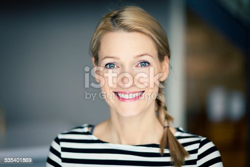 istock Close up Of A Smiling blond woman wearing a striped shirt 535401869