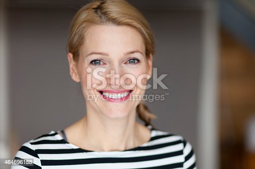 istock Close up Of A Smiling Italian blond woman 464696188