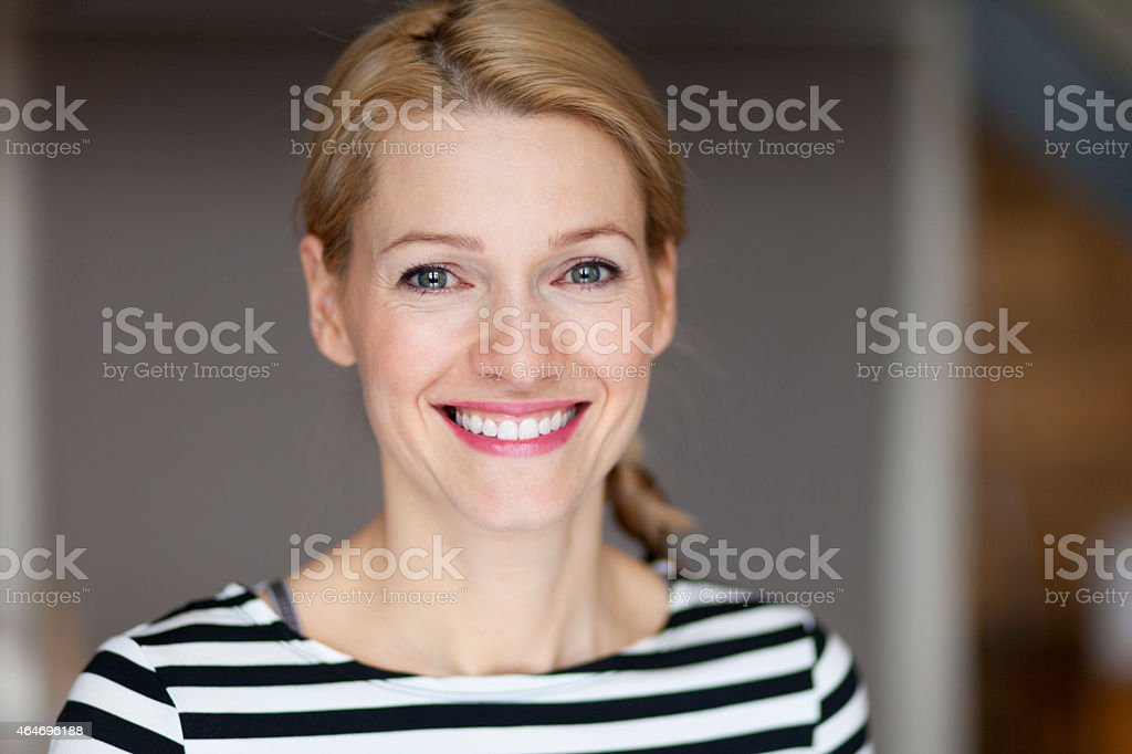 Close up Of A Smiling Italian blond woman stock photo