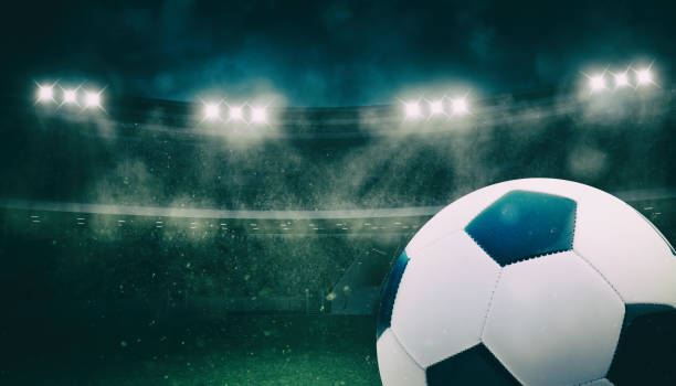 Close up of a soccer ball at the stadium during a night match - foto stock