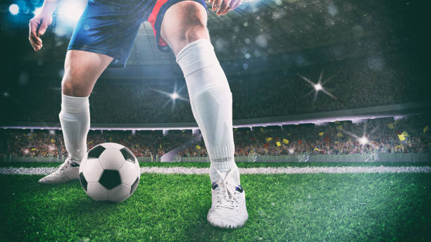 Close up of a soccer player holding the ball for a dribbling at the stadium during the night match - foto stock