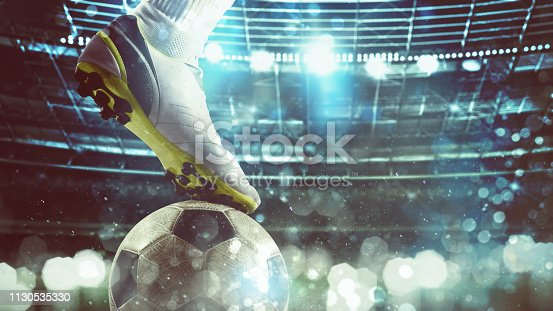istock Close up of a soccer striker ready to kicks the ball at the stadium 1130535330