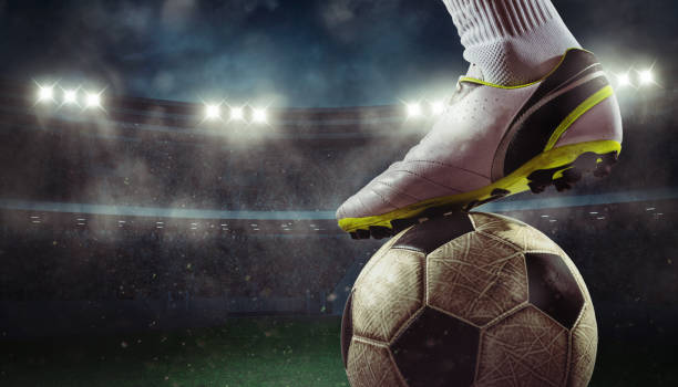 close up of a soccer striker ready to kicks the ball at the stadium - footbal стоковые фото и изображения