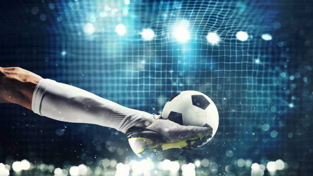 Close up of a soccer striker ready to kicks the ball in the football goal - foto stock
