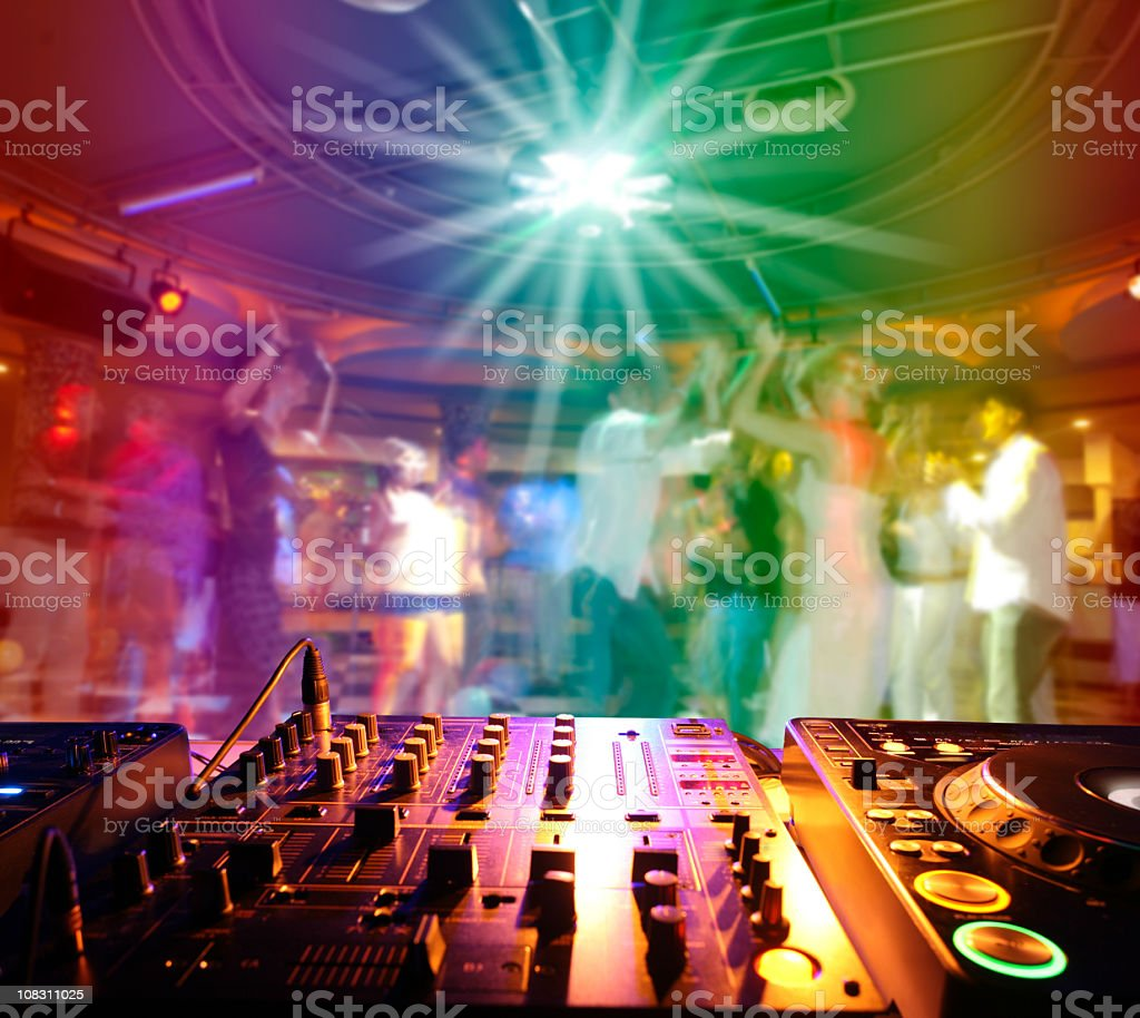Close up of a soundboard with lights and people dancing royalty-free stock photo