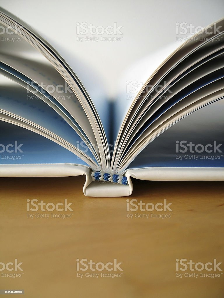 Close up of a spine of a book with open pages stock photo