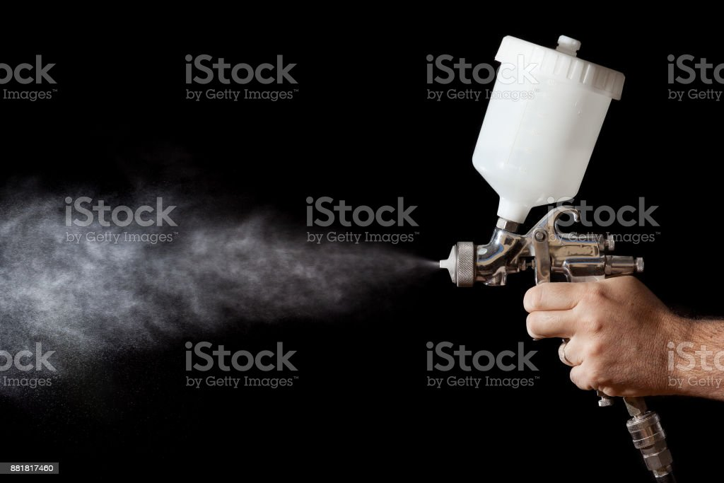 Close up of a spray paint gun with black background stock photo