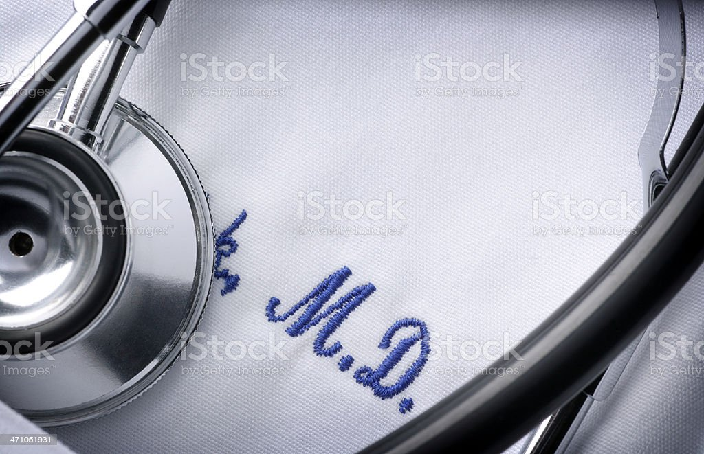 Close up of a stethoscope and embroidery on a doctor's jacket stock photo