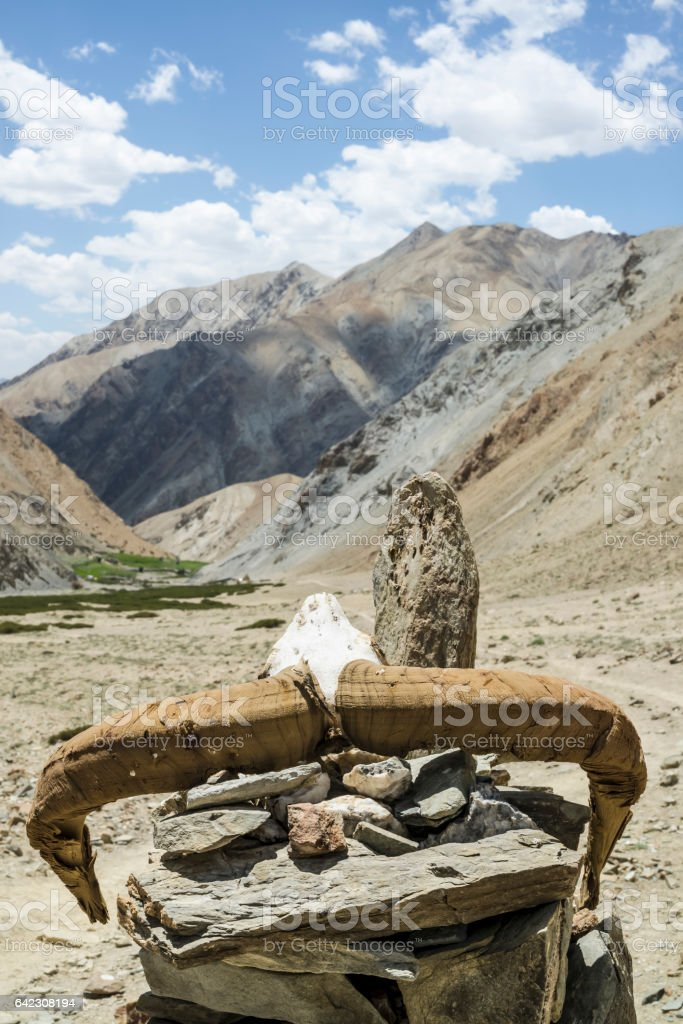 Close up of a stone landmark with antlers in GandaLa stock photo