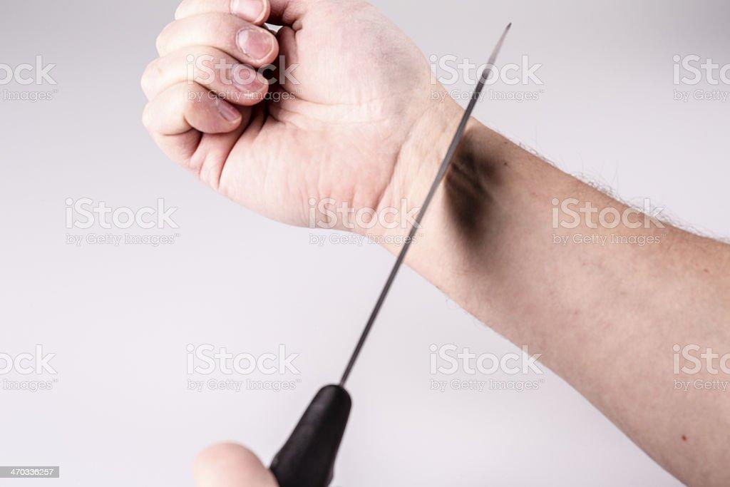 Close up of a suicidal man hand o stock photo