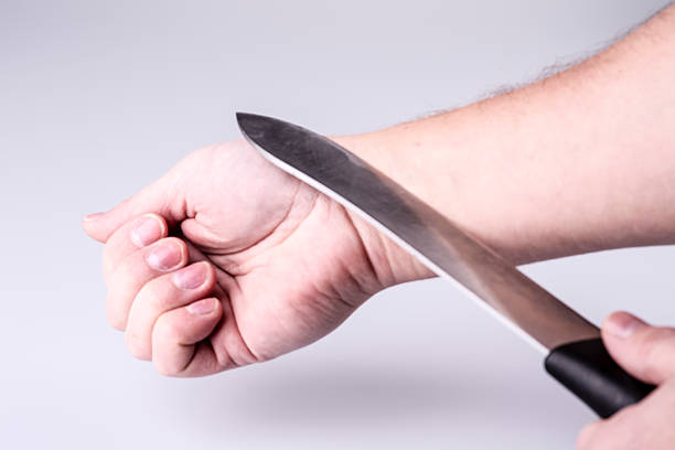 Close up of a suicidal man hand stock photo