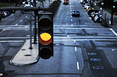 Close up of a traffic light on yellow