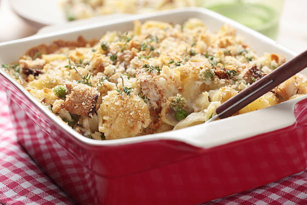 close up of a tuna casserole in a red dish  - casserole stock photos and pictures
