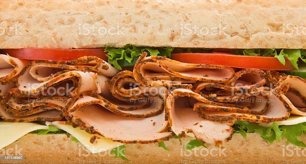 Close up of a turkey/chicken breast submarine sandwich royalty-free stock photo
