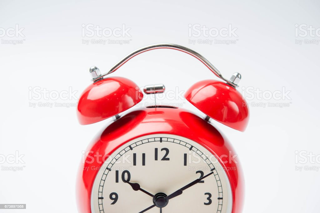 close up of a vintage red bell clock on white background foto de stock royalty-free