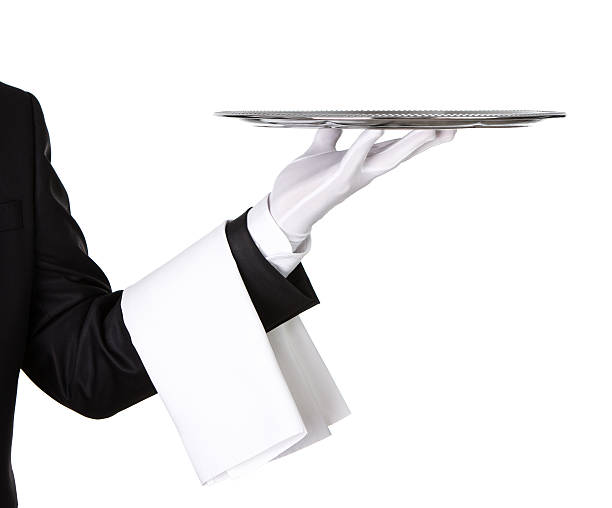Close up of a waiter holding silver tray stock photo