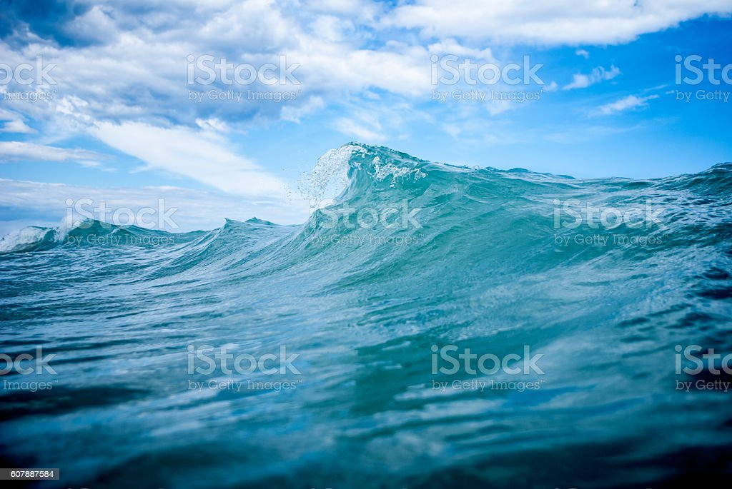 Close up of a wave in the ocean. stock photo
