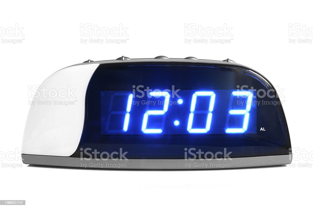 Close up of a white digital alarm clock with blue numbers stock photo