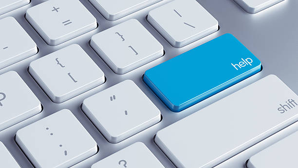 Close up of a white keyboard focusing on the blue help key