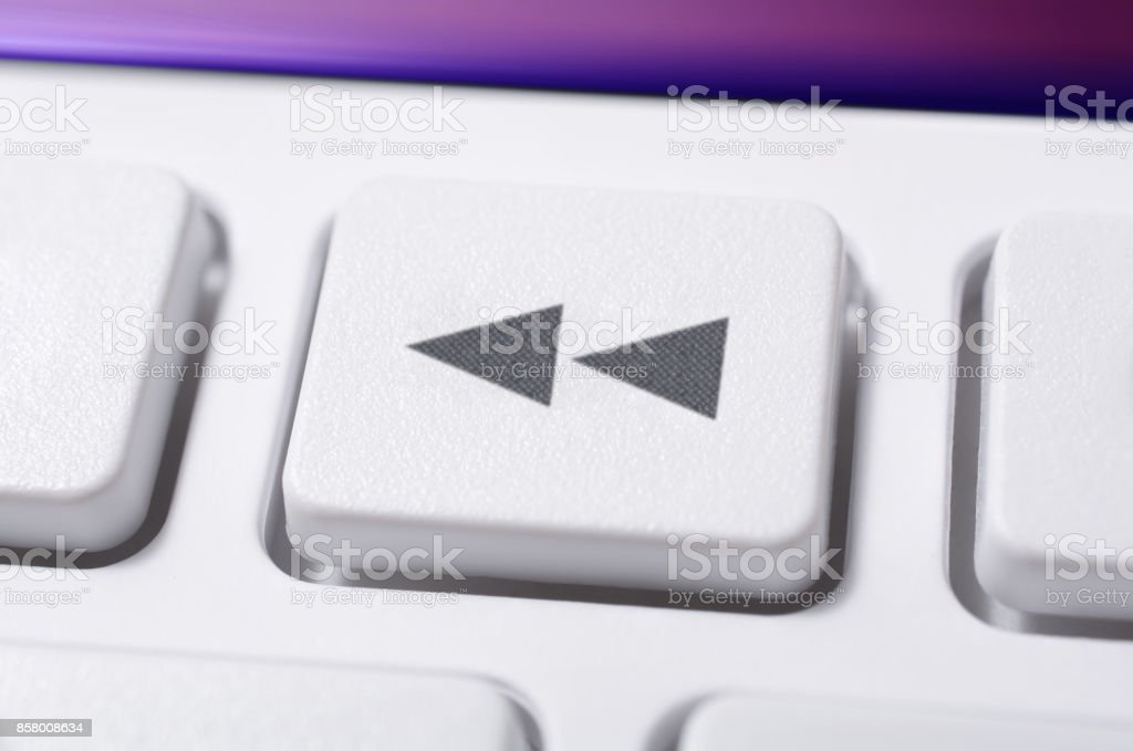 Close Up Of A White Rewind Button Of A White Remote Control For A Hifi Stereo Audio System stock photo