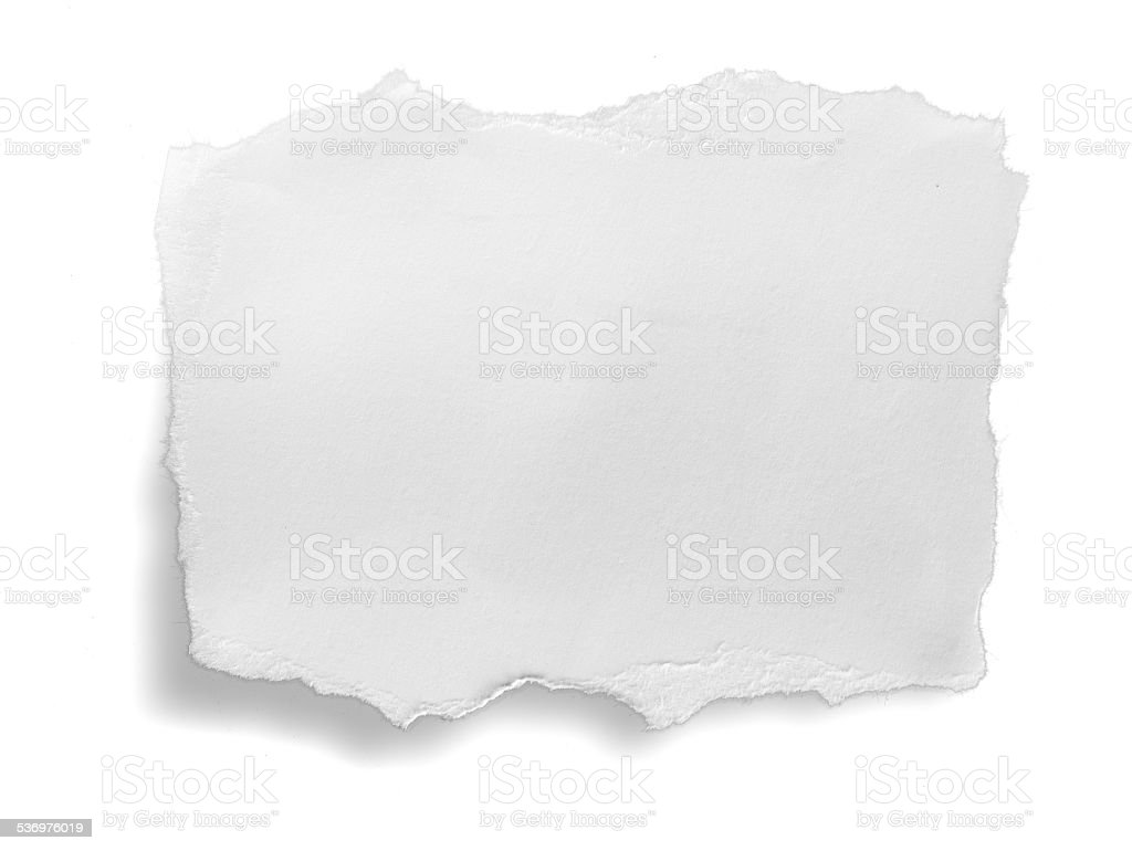 close up of a white ripped piece of paper stock photo