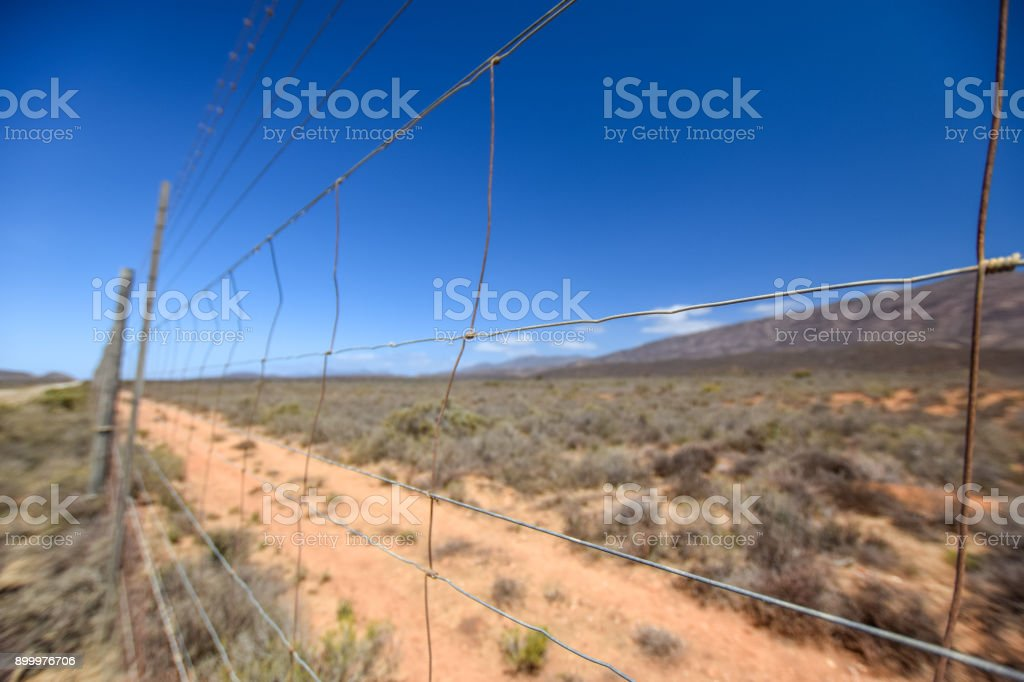 Close up of a wire mesh border fence near the town of Prince Albert in the Swartberg Mountain range, Western Cape Province, South Africa. stock photo