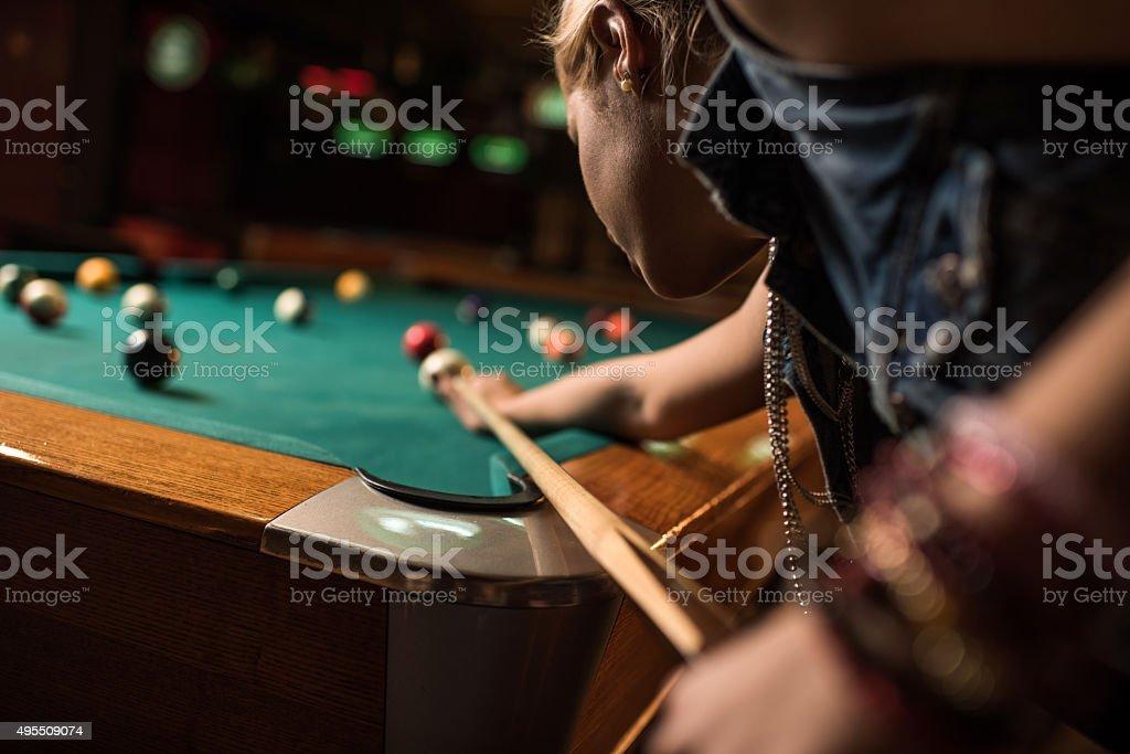 Close up of a woman aiming at pool ball. stock photo