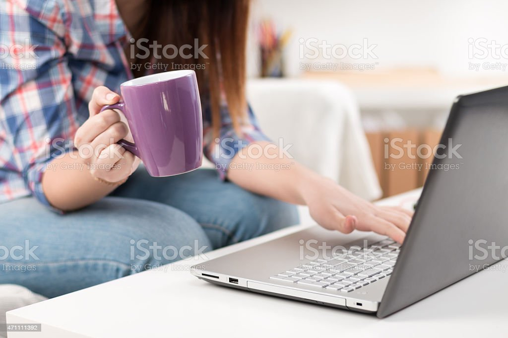 Close up of a woman hands typing in a laptop stock photo