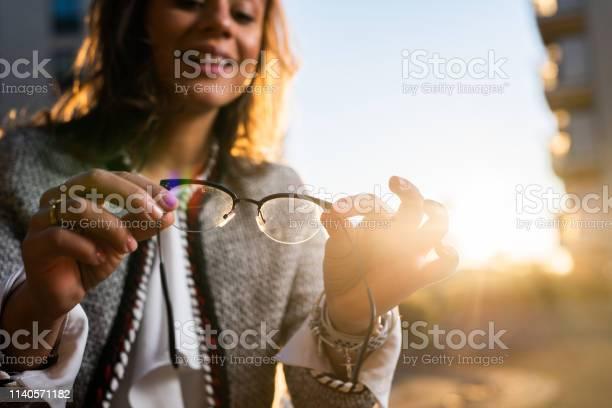 Close up of a woman holding eyeglasses before using them picture id1140571182?b=1&k=6&m=1140571182&s=612x612&h=gfotv ghallboift5puzygjbgwwrrqm iyaa9g blba=
